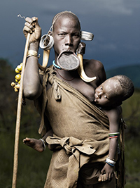Mother and Infant - Mursi Tribe from Omo Valley Project by photographer Joey Lawrence